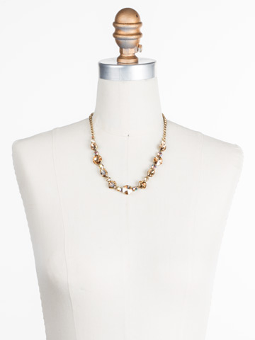Full Circle Necklace in Antique Gold-tone Neutral Territory displayed on a necklace bust