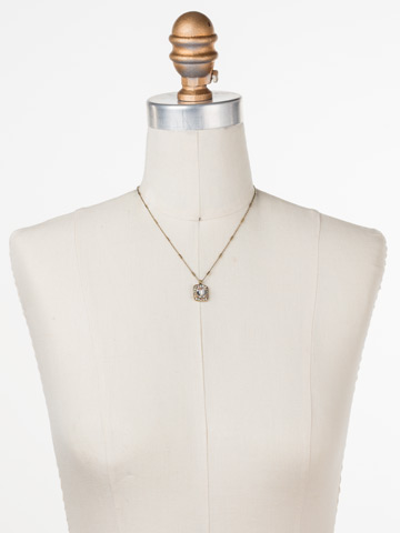 Opulent Octagon Necklace in Antique Gold-tone White Magnolia displayed on a necklace bust