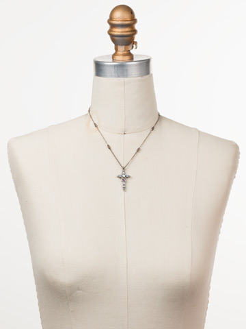 Delicate Sliding Cross Pendant Necklace in Antique Silver-tone Glacier displayed on a necklace bust