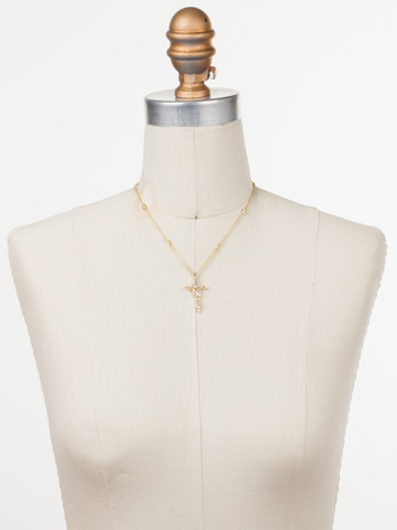 Delicate Sliding Cross Pendant Necklace in Bright Gold-tone Silky Clouds displayed on a necklace bust