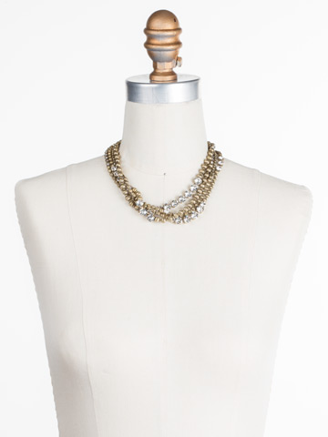 Jessamine Necklace in Antique Gold-tone Crystal displayed on a necklace bust