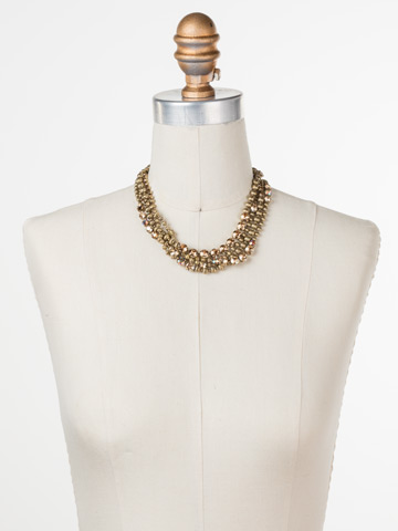 Jessamine Necklace in Antique Gold-tone Neutral Territory displayed on a necklace bust