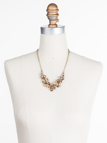 Forget-Me-Not Necklace in Antique Gold-tone Neutral Territory displayed on a necklace bust