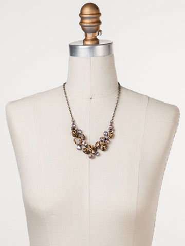 Forget-Me-Not Necklace in Antique Silver-tone Mirage displayed on a necklace bust