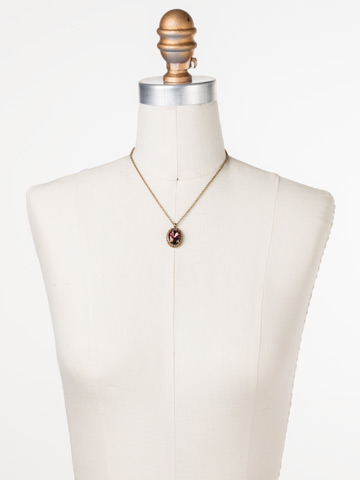 Camellia Pendant Necklace in Antique Gold-tone Mahogany displayed on a necklace bust