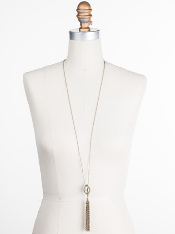 Camellia Tassle Necklace in Antique Gold-tone Crystal displayed on a necklace bust