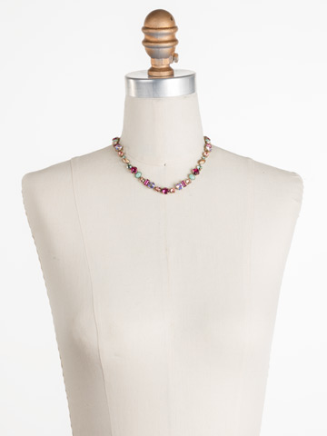 Constantia Necklace in Antique Gold-tone Radiant Sunrise displayed on a necklace bust