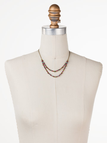 Vinca Necklace in Antique Gold-tone Botanical Brights displayed on a necklace bust