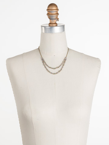 Vinca Necklace in Antique Gold-tone Washed Waterfront displayed on a necklace bust