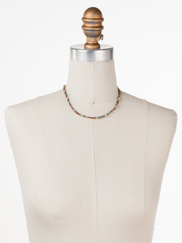 Resort 2018 One-of-a-Kind Necklace in Antique Gold-tone Botanical Brights displayed on a necklace bust