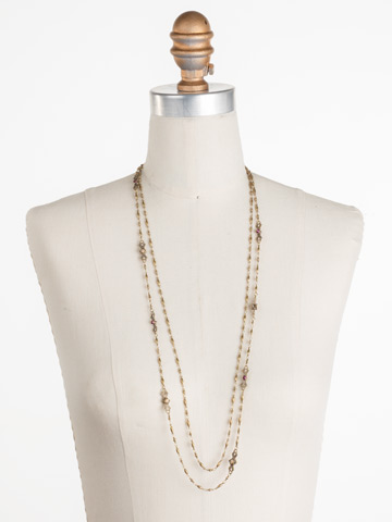 Sage Necklace in Antique Gold-tone Radiant Sunrise displayed on a necklace bust