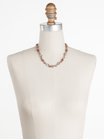 Kalmia Necklace in Antique Gold-tone Radiant Sunrise displayed on a necklace bust