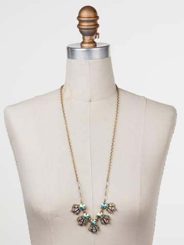 Alstromeria Necklace in Antique Gold-tone Snowflake displayed on a necklace bust