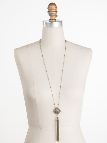 Freesia Necklace in Antique Gold-tone Radiant Sunrise displayed on a necklace bust