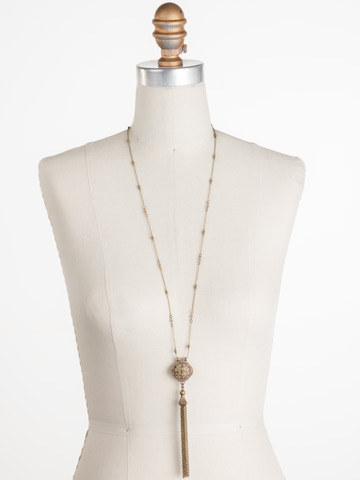 Freesia Necklace in Antique Gold-tone Washed Waterfront displayed on a necklace bust