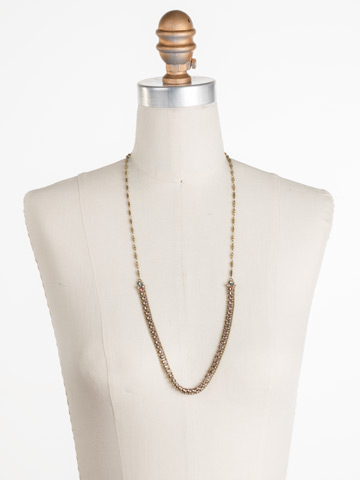 Nerine Necklace in Antique Gold-tone Radiant Sunrise displayed on a necklace bust