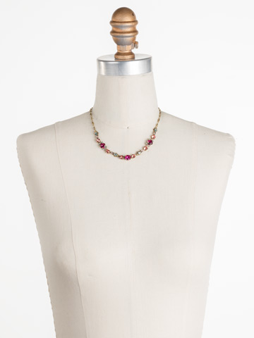 Saffron Necklace in Antique Gold-tone Radiant Sunrise displayed on a necklace bust