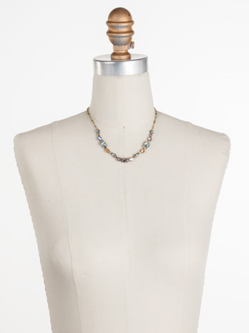 Saffron Necklace in Antique Gold-tone Washed Waterfront displayed on a necklace bust