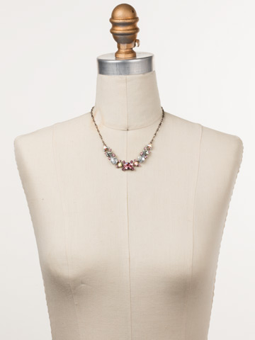 Laurel Necklace in Antique Silver-tone Misty Pink displayed on a necklace bust