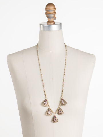Aconitum Necklace in Antique Gold-tone Radiant Sunrise displayed on a necklace bust
