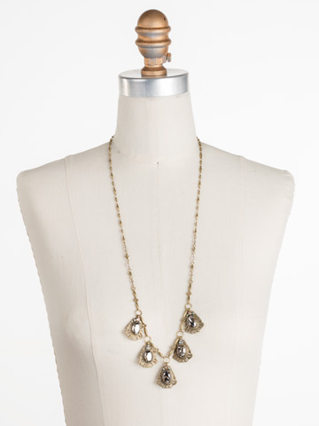 Aconitum Necklace in Antique Gold-tone Washed Waterfront displayed on a necklace bust