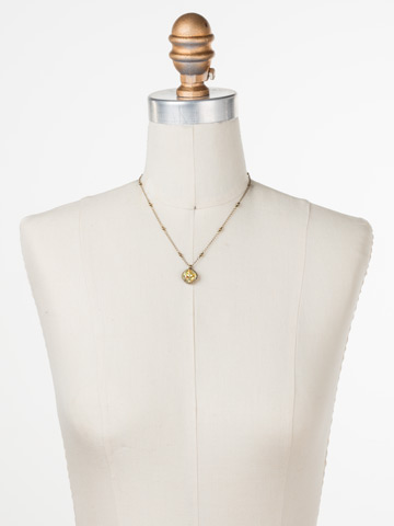 Cushion-Cut Solitaire Necklace in Antique Gold-tone Crystal Champagne displayed on a necklace bust