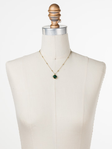 Cushion-Cut Solitaire Necklace in Antique Gold-tone Emerald displayed on a necklace bust