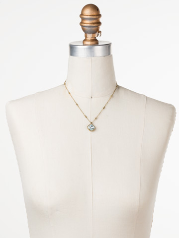 Cushion-Cut Solitaire Necklace in Antique Gold-tone Light Aqua displayed on a necklace bust