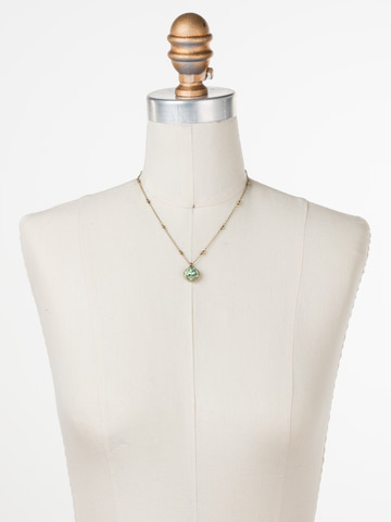 Cushion-Cut Solitaire Necklace in Antique Gold-tone Mint displayed on a necklace bust