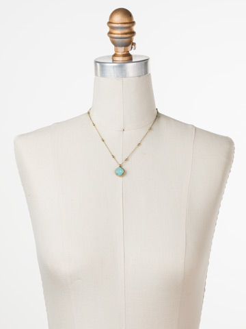 Cushion-Cut Solitaire Necklace in Antique Gold-tone Pacific Opal displayed on a necklace bust