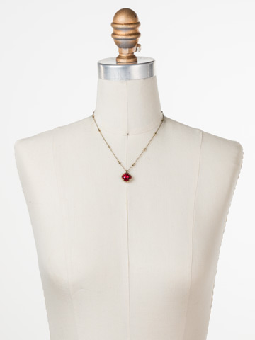 Cushion-Cut Solitaire Necklace in Antique Gold-tone Siam displayed on a necklace bust