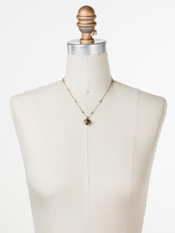 Cushion-Cut Solitaire Necklace in Antique Gold-tone Volcano displayed on a necklace bust