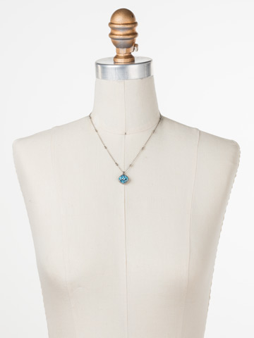 Cushion-Cut Solitaire Necklace in Antique Silver-tone Aquamarine displayed on a necklace bust