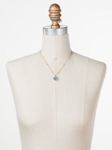 Cushion-Cut Solitaire Necklace in Bright Gold-tone Crystal Aurora Borealis displayed on a necklace bust