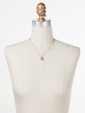 Cushion-Cut Solitaire Necklace in Bright Gold-tone Dark Champagne displayed on a necklace bust