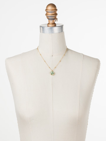 Cushion-Cut Solitaire Necklace in Bright Gold-tone Mint displayed on a necklace bust