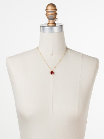 Cushion-Cut Solitaire Necklace in Bright Gold-tone Siam displayed on a necklace bust