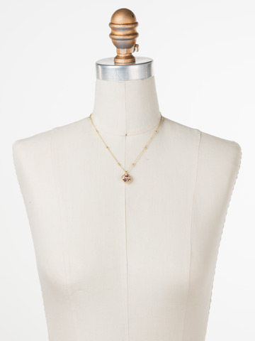 Cushion-Cut Solitaire Necklace in Bright Gold-tone Vintage Rose displayed on a necklace bust