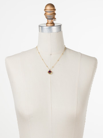 Cushion-Cut Solitaire Necklace in Bright Gold-tone Volcano displayed on a necklace bust
