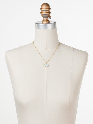 Cushion-Cut Solitaire Necklace in Bright Gold-tone White Opal displayed on a necklace bust