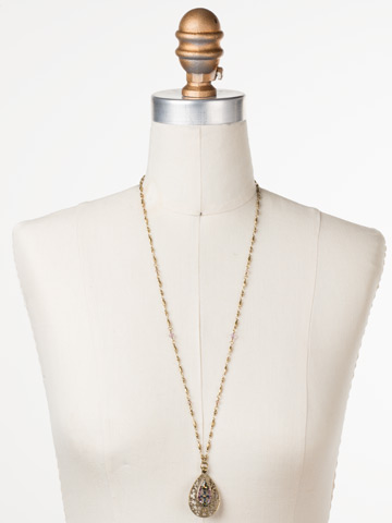 Cosmos Necklace in Antique Gold-tone Royal Plum displayed on a necklace bust