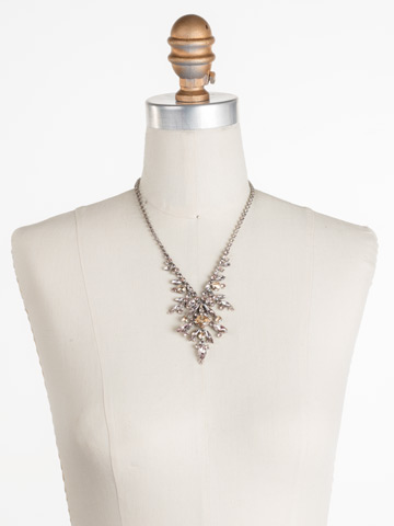 Aubretia Necklace in Antique Silver-tone Satin Blush displayed on a necklace bust