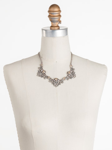Linden Statement Necklace in Antique Silver-tone Satin Blush displayed on a necklace bust