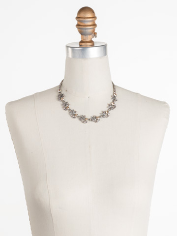 Linden Necklace in Antique Silver-tone Satin Blush displayed on a necklace bust