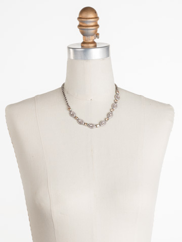 Moonflower Necklace in Antique Silver-tone Satin Blush displayed on a necklace bust