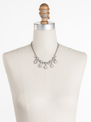Posey Statement Necklace in Antique Silver-tone White Bridal displayed on a necklace bust