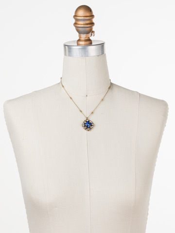 Oxeye Daisy Necklace in Antique Gold-tone Wildflower displayed on a necklace bust