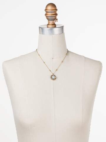 Allium Necklace in Antique Gold-tone White Magnolia displayed on a necklace bust
