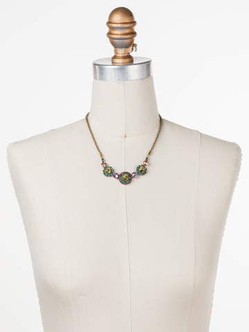 Snapdragon Necklace in Antique Gold-tone Wildflower displayed on a necklace bust