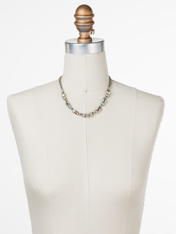 Forsynthia Necklace in Antique Gold-tone White Magnolia displayed on a necklace bust